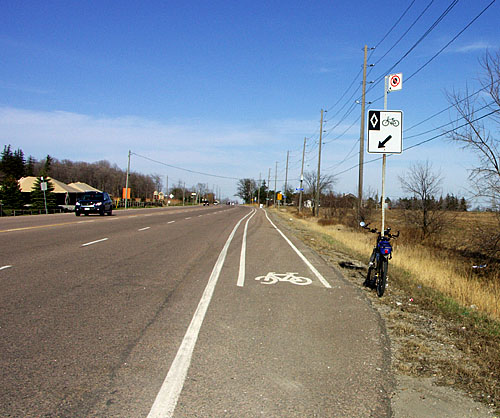 A bike lane appears on Steeles Ave. East