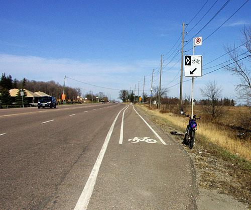 A bike lane appears on Steeles Ave. East