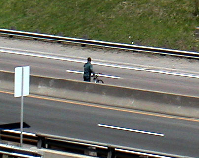 Cyclist crossing the DVP