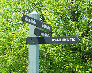 An older wayfinding sign in the Don Valley points the (wrong) way
