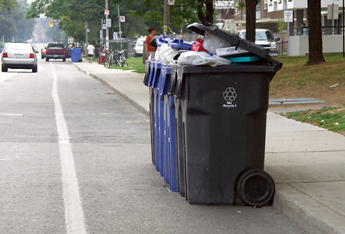 55 Cosburn Ave. puts its garbage in the bike lane