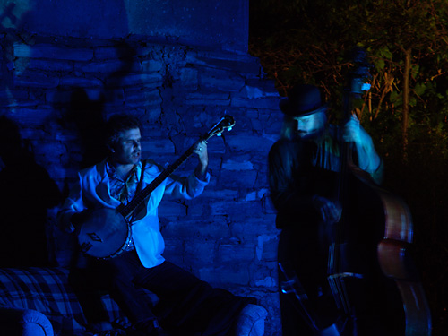 Sean Dixon plays the banjo under the old Don River bridge