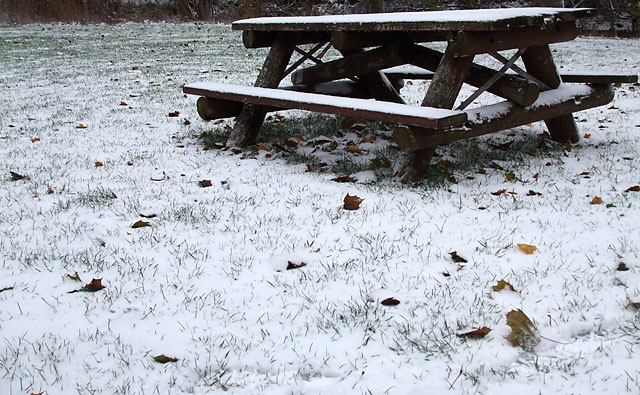 Snow-dusted picnic table