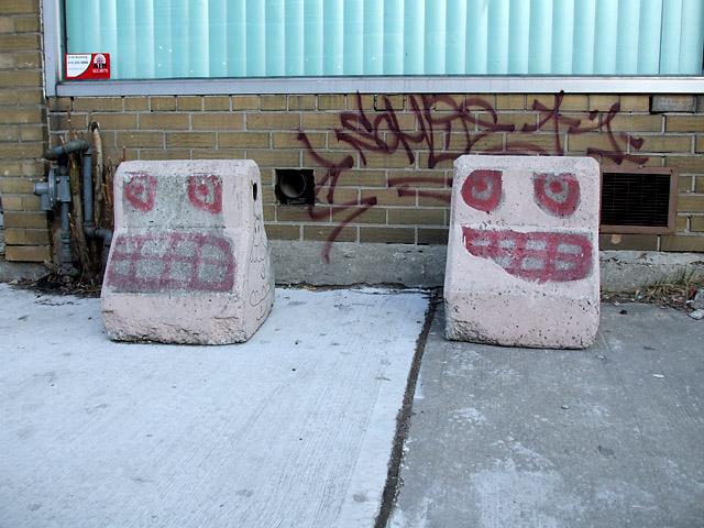 Faces on concrete barriers in Kensington Market
