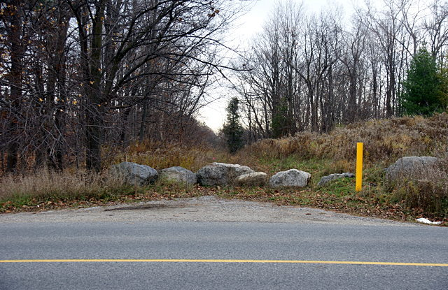 A row of rocks blocks access to Passmore Avenue from Reesor Road