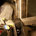 You need to drill holes in the brackets for both the top and bottom tubes that run the length of each side of the trailer. If you use self-tapping screws rather than pop rivets, you don't need to drill.