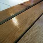 """I chose red oak for the trailer bed, largely because I had some lying around from a previous project. I planed it down to 5/8"""" to keep it light. If you're using a softer wood, you should keep it a bit thicker. Here, the slats are drying after a second coat of Varathane. Cedar would also be a good choice for the bed, as would a plain old sheet of exterior plywood. If you don't have a saw, you can take your trailer to Home Depot, have them cut a piece to size, and you can carry it home on your trailer to finish assembly. You can use pretty much any hard-wearing exterior finish here, including paint or tung oil. If you really want shine and a bullet-proof finish, try marine spar varnish. But it'll cost you."""