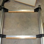 The wooden crosspieces have been mounted to the frame and are ready for the slats to be fastened. I chose this design rather than attaching the slats directly to the aluminum crosspieces because it means that the entire bed is attached to the trailer frame with only six screws, greatly easing any future replacement or maintenance.