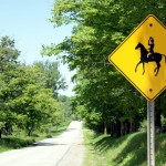 Even the signs reflect King's serious horsiness: instead of depicting a normal rider shuffling along on some random horse, the warning signs show a hunter or show jumper doffing his cap at passing traffic while his horse trots across the road.