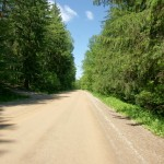 Continuing into the Real Dufferin Jog, the street becomes a dirt road along the tree-lined floor of a very quiet valley.