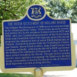 """A historic plaque in the hamlet of <a href=""""http://en.wikipedia.org/wiki/Ansnorveldt%2C_Ontario"""">Ansnorveldt</a> detailing the Dutch settlements in the Holland Marsh. It's funny that Dutch emigrants would move to Canada and seek out a low-lying marshy area with lots of canals that was quite similar to what they left behind. Also, I didn't realize that the Holland Marsh as a farming area was established as recently as the 1930s."""