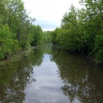 """Heading back east from Dufferin, this is one of many canals that branch off the Holland River, as seen from the intersection of <a href=""""http://maps.google.com/maps?q=Pumphouse+Road+%26+Graham+Sideroad,+King&ie=UTF8&t=h&z=16&iwloc=A"""">Pumphouse Road and Graham Sideroad</a>."""