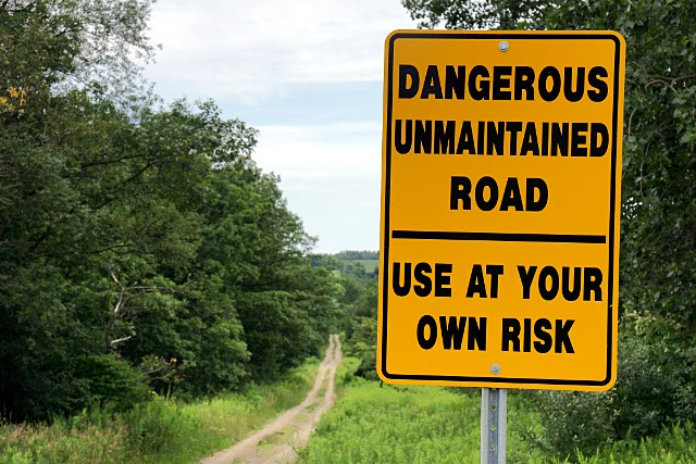 Dangerous unmaintained road sign