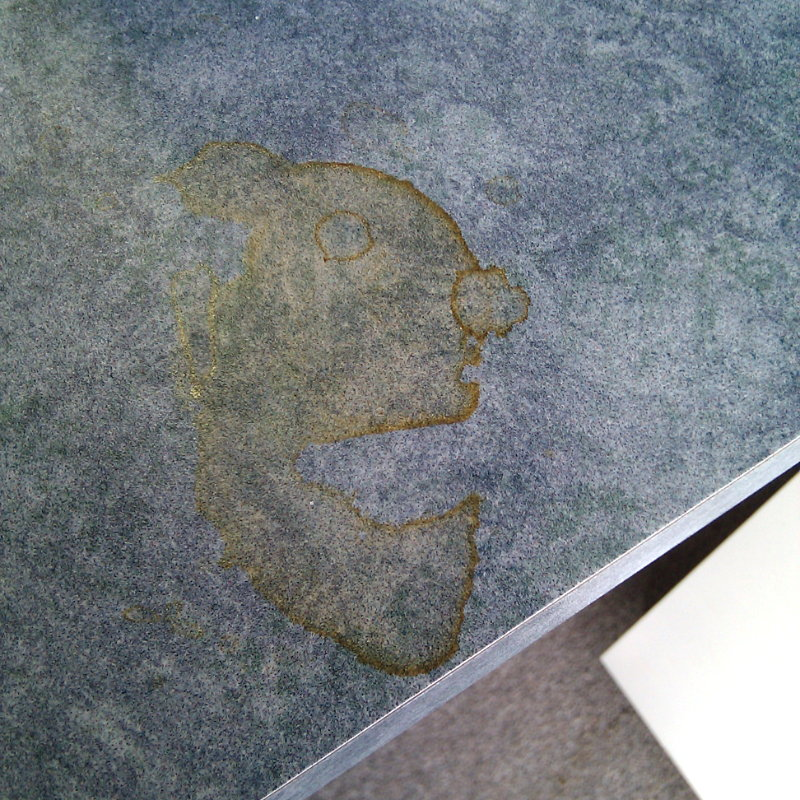 Face in a coffee stain