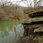 Concrete slabs leaning toward the river