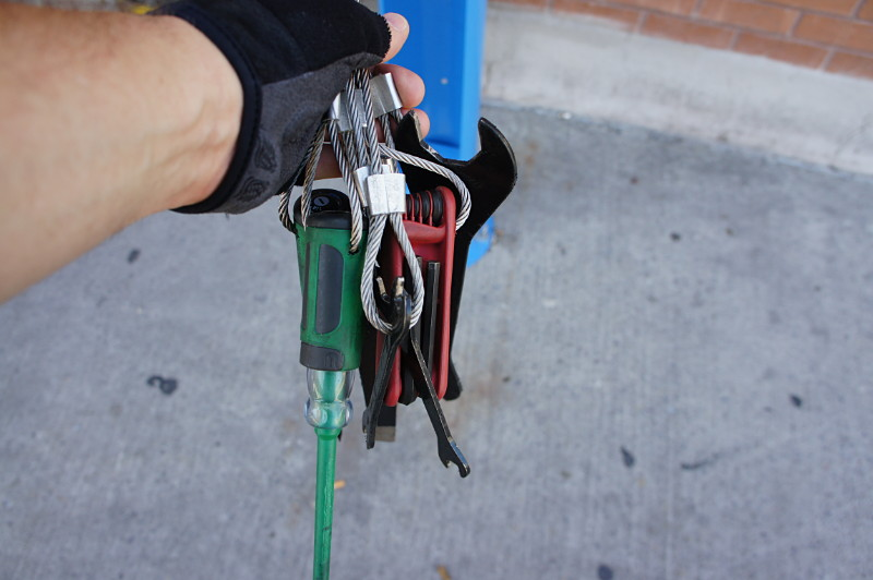 Tools available at the public bike repair stand.