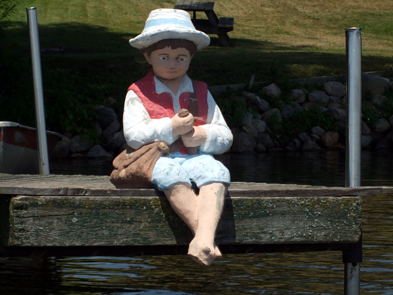 Doll on a dock