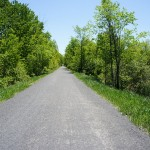 The trail is smooth and flat, with gentle grades and curves along the entire length.