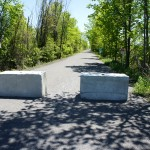 Farmers must drive some farm equipment across the trail in many areas, and large concrete barriers have been placed in those sections to prevent vehicular incursions onto the trail.