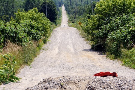 Lone jogger on a hot road