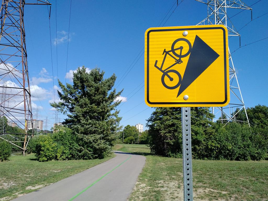 Bike on very steep hill sign