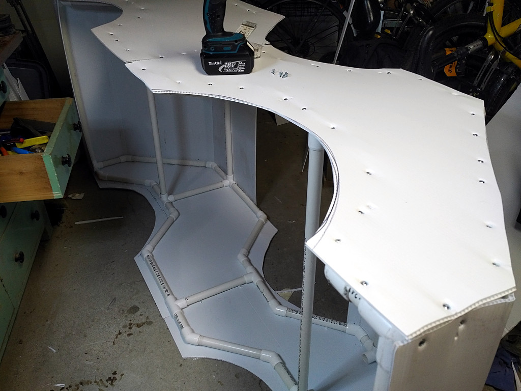 Body panels screwed onto the frame.